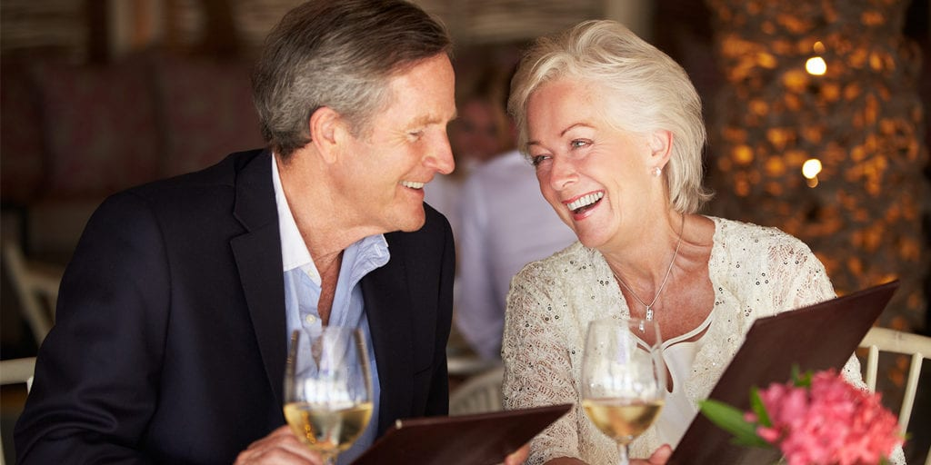 smiling old couple in a restaurant